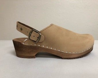 Nude nubuc Low heel clog with ankle strap and bronze studds and buckle