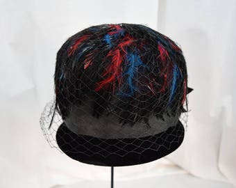Vintage 1960s black velvet with red, teal and black feathers beehive hat by Sauve'