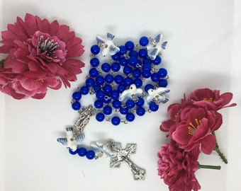 Rose wreath with blue beads and pigeons