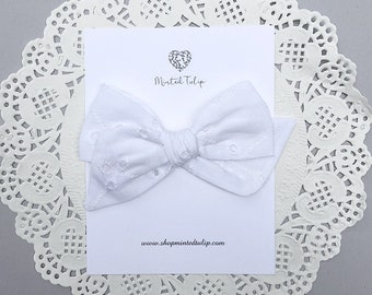 White Eyelet Small or Large Pinwheel Bow on Headband or Hair  Clip Baby Toddler Kids