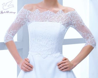 Bridal top (wedding bolero) of lace with shoulder off for a wedding dress