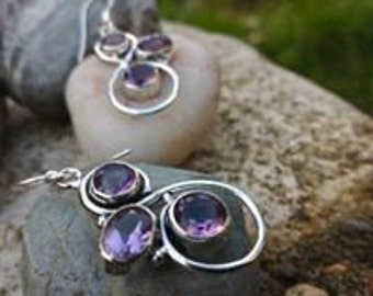 The softness of the Amethyst dangle earrings