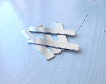 UK made 12x50mm Aluminium metal blanks rectangle 1.5mm thick. Ideal for hand stamping.