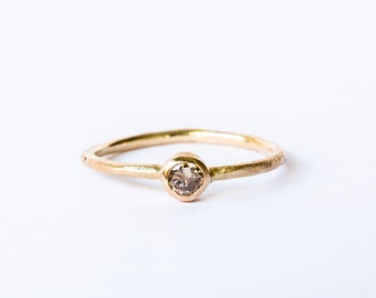 Champagne diamond ring on rough gold band, alternative engagement ring