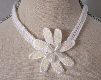 White flower cotton necklace adorned with pearls and sequins.