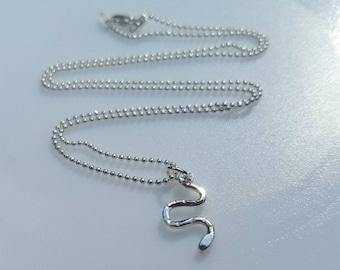 Tiny sterling silver snake pendant