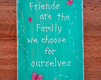 """Butterfly wall art plaque with saying, """"Friends are the Family we choose for ourselves""""."""