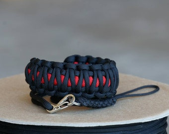 Adjustable paracord camera wrist strap. Any color combo including thin line style.