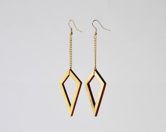 Wind, gold-colored earrings with wooden hangers