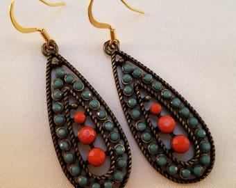 Turquoise and orange dangle earrings