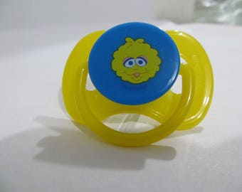 My Baby Alive 2010 Magnetic Pacifier or Reborn Doll Pacifier.  Yellow Baby Big BIrd.  Use drop down menu to see choices.  NO DOLL.  OOAK.