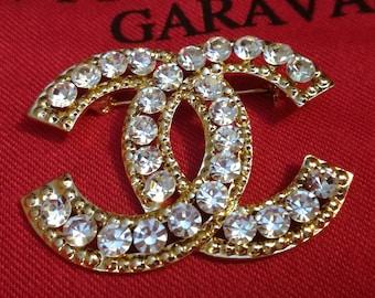 Fashion Elegant Rhinestone encrusted Designer inspiration pin brooch
