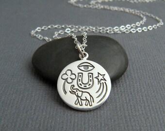 sterling silver good luck charm necklace. horseshoe. elephant. shamrock clover. lucky shooting star. evil eye pendant. totem jewelry. amulet
