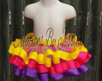 Purple, Pink, and Yellow ribbon trim tutu.. Purple ribbon trim tutu.. Pink ribbon trim tutu.. Yellow ribbon trim tutu
