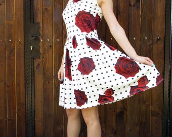 Elegant short summer dress  with red  roses  and  black dots