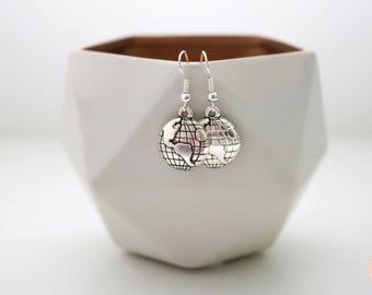 Around the world drop world globe earrings.