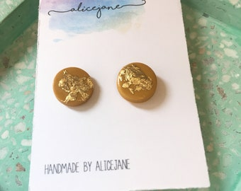 Small mustard and gold leaf studs.
