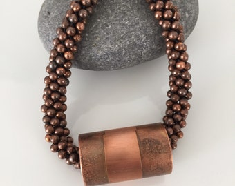 Copper beaded necklace with focal etched tube