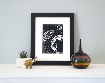 Exploring the Catmosphere - A Cat in Outer Space Inspired Woodcut, Featuring an Astronaut and Rocket Ship! Woodblock Print by DinoCat Studio