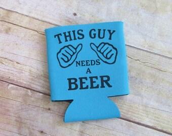 This Guy Needs a Beer Funny Can Cooler Beverage Holder Drink Hugger Blue Black