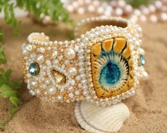 Beautiful Blue Sea. Beaded bracelet. Ceramic blue Ammonite