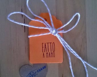 """""""made with hands"""" tags-tags orange with stamped """"made by hand"""""""
