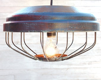 Hanging light from reclaimed chicken feeder brought back to life in dark bronze finish