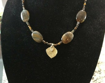 handcrafted necklace with Gold Aspen Leaf charm and tiger eye beads and matching bracelet.