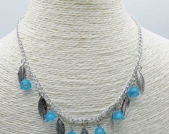 Turquoise blue flowers necklace in glass beads and lucite beads