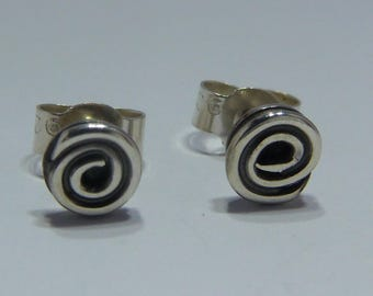 Swirly silver stud earrings