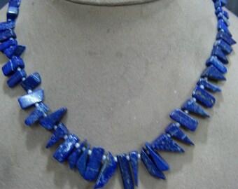 1 Strand   Lapis lazuly   Layout rough  beads  16''  48, grams  7X8  7X20  MM
