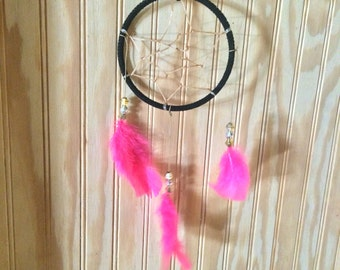 black and pink dream catcher