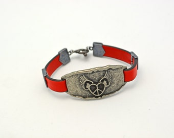 Long Distance Love Bracelet. Faux Red Leather and Pewter Bracelet w/ wings on a heart symbol, tierra cast gunmetal accents. Handcrafted Gift