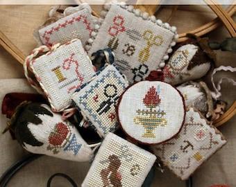 HEARTSTRING SAMPLERY Stitching Edition Festive Little Fobs cross stitch patterns at thecottageneedle.com 2018 Nashville Market