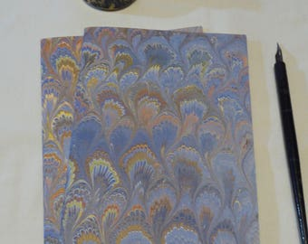 Blue, gold, orange and cream hand marbled paper hand sewn notebook, lined interior paper