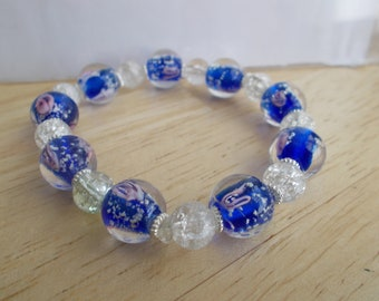 Stretch Bracelets made with Blue and Clear Murano Glass Beads with Silver  Spacers.