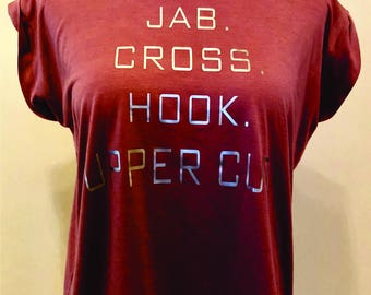 "Fit Boxing Inspired ""Jab. Cross. Hook. Upper Cut.,"" Bella Rolled Sleeve Muscle Shirt"