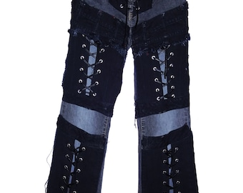A pair of Faded Vintage Black jeans with front lace ups