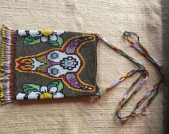 Fabulous Bronze beaded shoulder bag.  This bag is fully lined and has a zipper at the top.