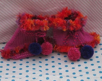 Hand knitted baby bootees with pompoms