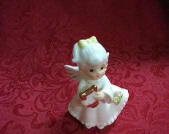 Vintage ceramic angel with harp. Made in the UK. As Coronet angel.