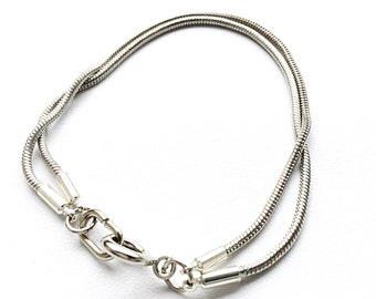 Double Stacked Stainless Steel Snake Chain Bracelet. This piece will arrive with a gift box and ribbon, ready for gift giving.