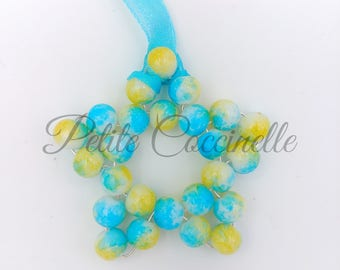 Star decoration in blue and yellow glass bead