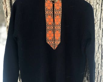 vintage wool/cashmere blend navy sweater with orange embroidered detail and gold chain hardware