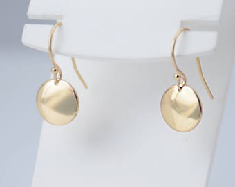 14K solid gold earrings. 14K solid gold tiny disc earrings. Tiny gold disc earrings. Simple earrings. Dainty earrings. Gift for her.