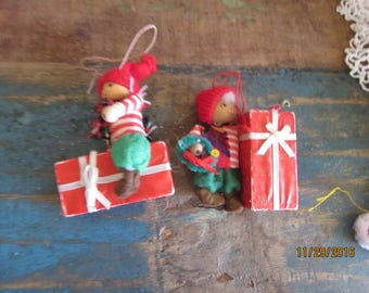 two vintage wooden ornaments