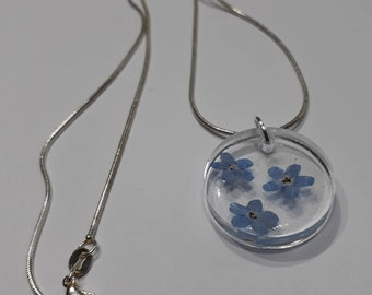 Resin necklace. Real forget me not flowers. Handmade 925 sterling silver chain. Lobster claw clasp. Memory