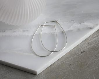 Hammered silver  hoops. Hammered silver, delicate hoop earrings. Horseshoe shaped hoops.