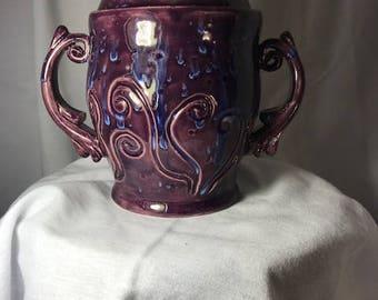 Purple tea jar with scroll design