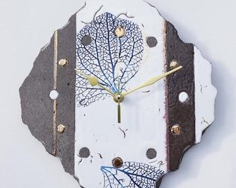 Glazed lava clock random cuts, organic white and touches of gold.